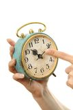Old alarm clock in hands. Isolated on white Stock Photography