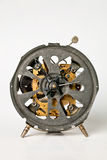 Old alarm clock mechanism. An alarm clock without case, visible mechanism, front view Royalty Free Stock Photo