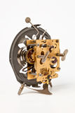 Old alarm clock mechanism. An alarm clock without case, visible mechanism, rear view Stock Images