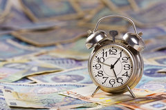 Old alarm clock and money Royalty Free Stock Image
