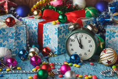 Old alarm clock near Christmas colored decorations Royalty Free Stock Photography