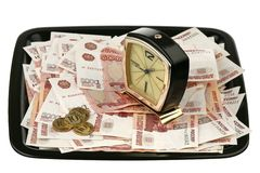 Old alarm clock and new money Royalty Free Stock Photography