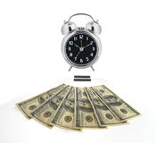 Time is money. Old alarm clock over money to illustrate the concept,  time is money Stock Photos