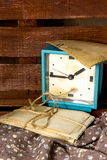 Old alarm clock and pictures Stock Photos