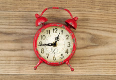 Old Alarm Clock on Rustic Wood Royalty Free Stock Image