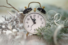 Old alarm clock showing five to midnight. Happy New Year! Stock Photos