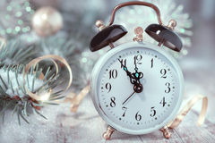 Old alarm clock showing five to midnight. Happy New Year! Royalty Free Stock Image