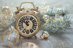 Old alarm clock showing five to midnight Royalty Free Stock Images
