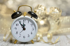 Old alarm clock showing five to midnight. Happy New Year! Stock Photo