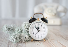 Old alarm clock showing five to midnight. Happy New Year! Royalty Free Stock Photo