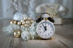 Old alarm clock showing five to midnight. Happy New Year! Royalty Free Stock Photos