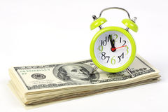 Old alarm clock standing on stack of money Stock Photography