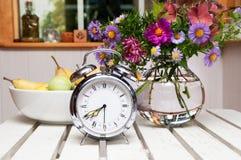 Old alarm clock in summer garden Royalty Free Stock Photo
