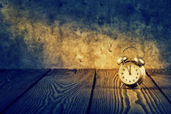 Old alarm clock under beam of light Stock Image