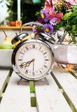 Old alarm clock on wooden table Stock Photo