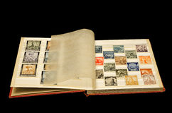 Old album with old post stamps. Two pages of old album with old historical Bulgarian post stamps, Isolated, clipping path included royalty free stock photo