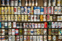 Old Alcohol Beer Can Hobby Collection. Display of an old beer can collection and alcohol beverages. Many people collect beer cans as a hobby Stock Photo