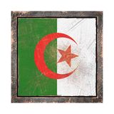Old Algeria flag. 3d rendering of an Algeria flag over a rusty metallic plate wit a rusty frame. Isolated on white background Stock Image