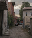 Old alley. With cars and a cat Stock Image