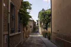 Old alley in the city centre of Ferrara Stock Photo