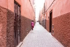 Old alley in historic medina in marrakesh, morocco royalty free stock images