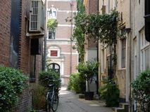 Old alley. An old alley with old houses bike and green plants Royalty Free Stock Photography