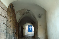 Old alley leading to a church. Narrow old alley leading to a church door Stock Photo