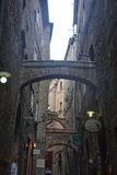 Old alley in the old town of Volterra in Italy with stone arch. And sky Royalty Free Stock Photos
