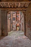 Old alley in Siena, Tuscany, Italy Royalty Free Stock Photos