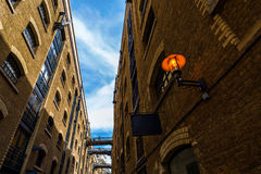 Old alley in Southwark, London. Old alley with footbridges in Southwark, London, UK stock photos