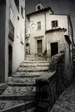 Old alley with steps. In a mountain village in central Italy stock photography