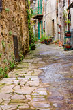 Old alley in Tuscany. Old narrow alley in tuscan village - antique italian lane in Tuscany, Italy Royalty Free Stock Photography