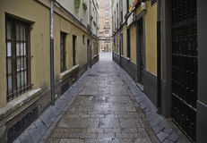 Old alley wet Stock Images