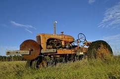 Old allis Chalmers tractor with attached saw Stock Images