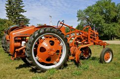 Old Allis Chalmers tractor with a belly blade Royalty Free Stock Images
