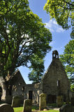 Old Alloway kirk. Portrait view of the  famous ruin of the haunted church mentioned in Robert Burns narrative poem, Tam oShanter, showing surrounding tall trees Stock Image