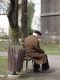 Old and alone. Old man in city taking a moment of rest Royalty Free Stock Photo