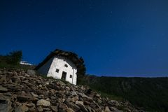 Old alpine chapel and starry sky Stock Photography
