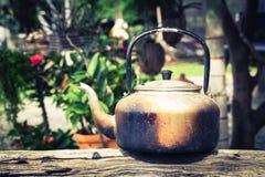 Old aluminium kettle on timber Royalty Free Stock Photos