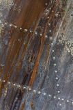 Old aluminum background detail of a military aircraft, surface corrosion. Royalty Free Stock Image