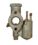 Old aluminum carburetor from an old motorcycle isolated on a whi Royalty Free Stock Image