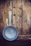 Old aluminum colander Royalty Free Stock Photos