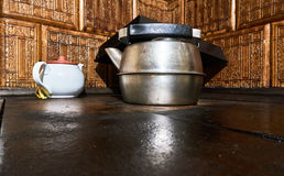 The old aluminum kettle on the stove. Tea pot. Stock Images