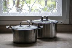 Old aluminum stainless steel cooking pot on kitchen table. Top Stock Images