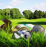 Old aluminum and tin cans. On a background of green field Royalty Free Stock Images