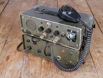 Old amateur ham radio on wooden table. Old dark green amateur ham radio on wooden table Royalty Free Stock Photos