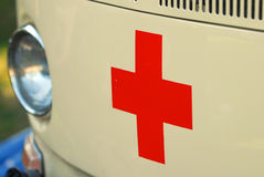 Old ambulance car. A red cross at the front of an old vw rescue car Royalty Free Stock Photography