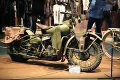 Old American army motorcycle Harley Davidson WLA42 khaki 1942, right side. General view. Time of the International motorcycle industry salon IMIS2018. Lenexpo royalty free stock photography