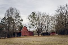 Old American barns. In winter stock photography