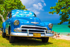 Old american car at a beach in Cuba Stock Photo